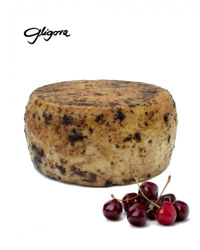 Tezacki cheese aged in pressed cheery skins