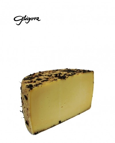 Tezacki cheese aged in pressed wine grapes